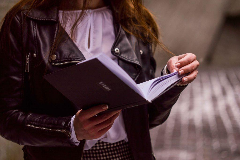influencer-reading-a-book-influencer-marketing-terms