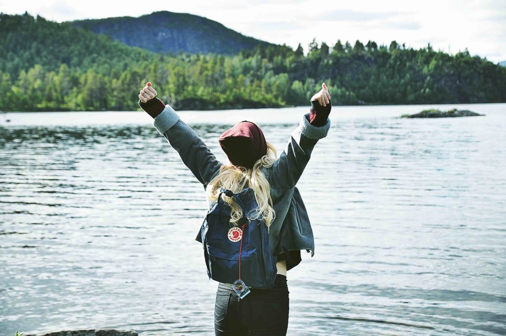 Instagram influencer marketing influencer raising hands to the sky in sweden